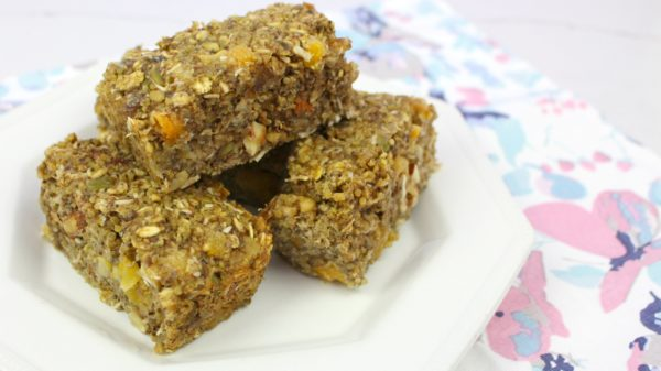 Lactation boosting breakfast bars with brewers yeast, oatmeal, and apricots. Make ahead for quick and easy breakfasts on the go or breastfeeding snacks.